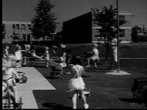1935 ws pan young children playing on playground/ jacksonville, florida - 1935 stock videos & royalty-free footage