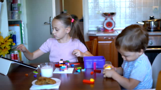 young children playing with plastic blocks at home. - brother stock videos & royalty-free footage
