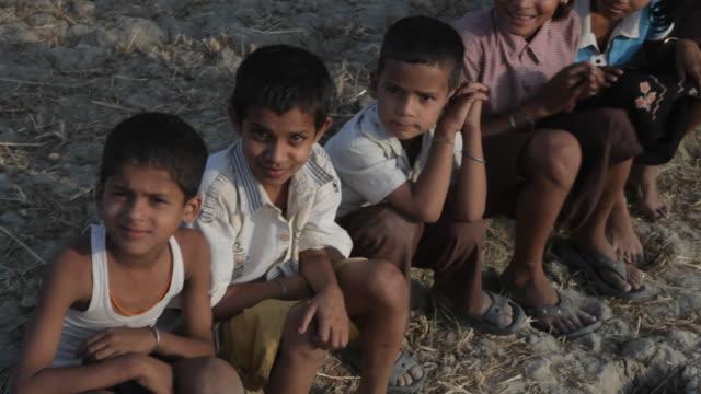 mh pan young children smiling / india - 大人数点の映像素材/bロール