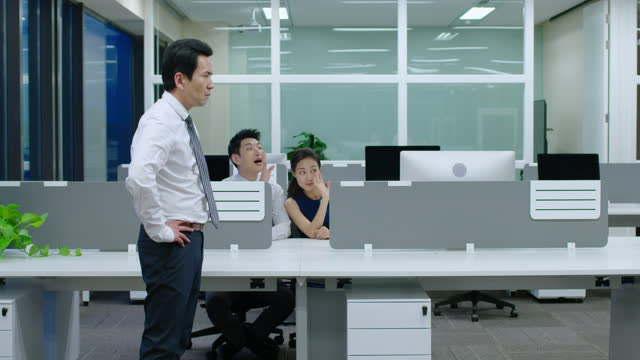 young chinese businessman being fired,4k - office politics stock videos & royalty-free footage