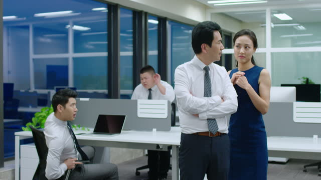 young chinese businesswoman telling secret to manager,4k - office politics stock videos & royalty-free footage