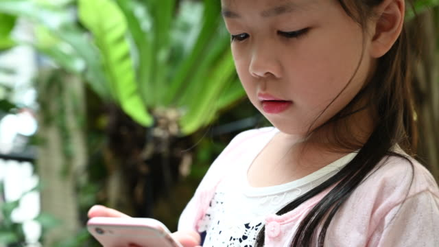 young chinese girl text messaging on phone - digital native stock videos & royalty-free footage