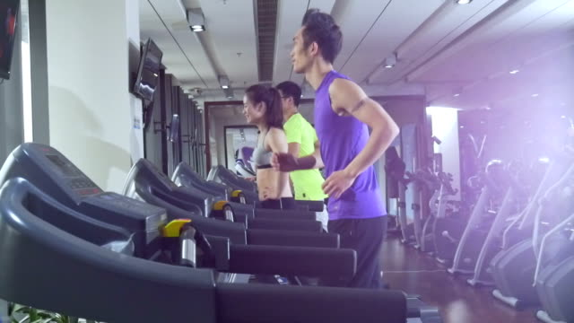 young chinese people work out in modern gym - sports hall stock videos & royalty-free footage