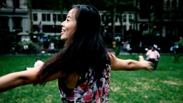 young chinese woman enjoy freedom in the city park - bryant park stock videos and b-roll footage