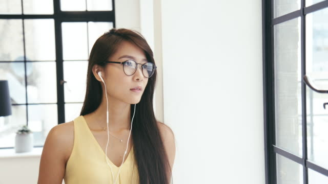 Young Chinese Woman listens to podcast