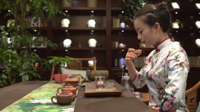 Young Chinese woman tasting tea