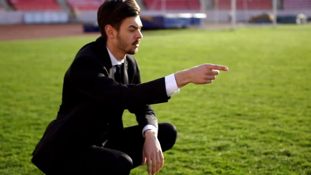 Young coach on soccer field