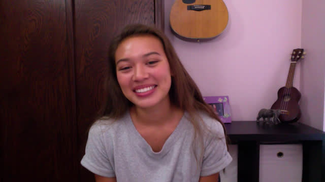 a young college girl laughs while paying attention during her zoom class - conference call stock videos & royalty-free footage