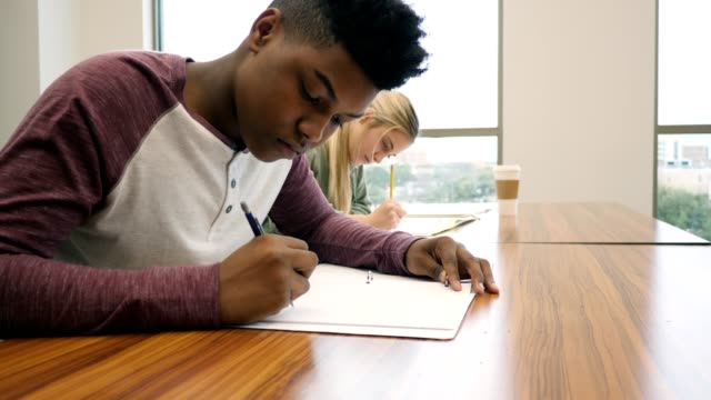 young college students concentrate while working during class - educational exam stock videos & royalty-free footage
