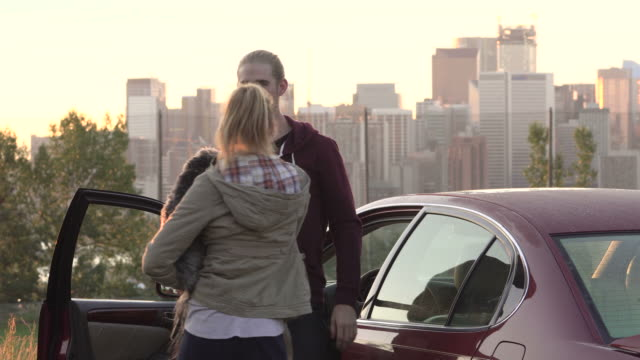 Young couple admire a city skyline view