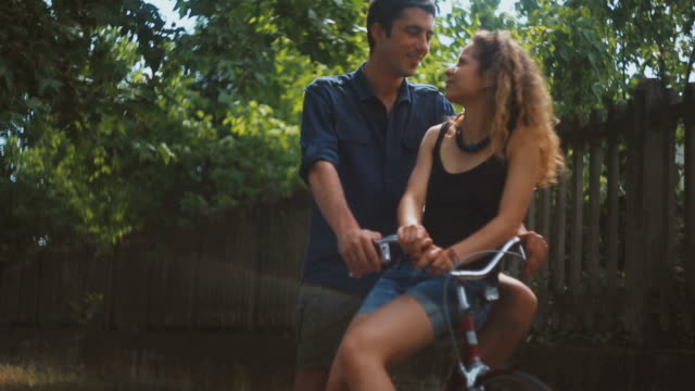 young couple and bicycles: relaxing and intimacy - hugging self stock videos & royalty-free footage