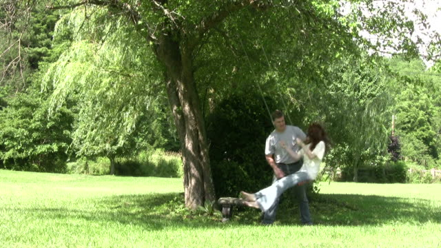 young couple and rope swing hd - rope swing stock videos & royalty-free footage