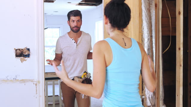 a young couple argues about their home renovation - diy stock videos & royalty-free footage