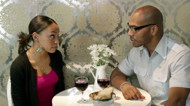 young couple arguing in cafe - kommunikationsproblem bildbanksvideor och videomaterial från bakom kulisserna