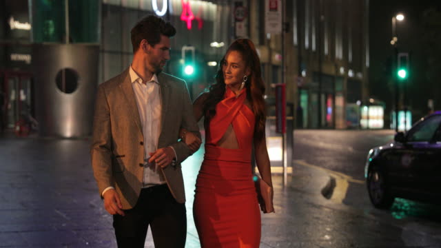 young couple arm in arm - nightlife stock videos & royalty-free footage