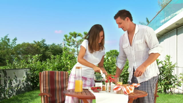 HD DOLLY: Young Couple At Breakfast