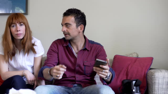 young couple at livingroom watching tv - middle east stock videos & royalty-free footage