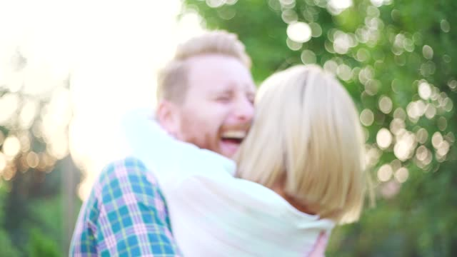 young couple at the backyard - formal garden party stock videos & royalty-free footage