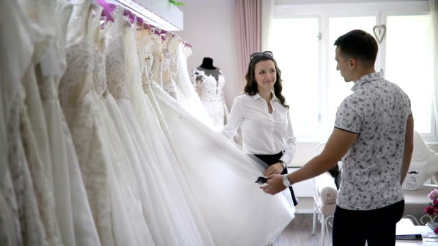 young couple at the bridal shop - wedding dress stock videos and b-roll footage
