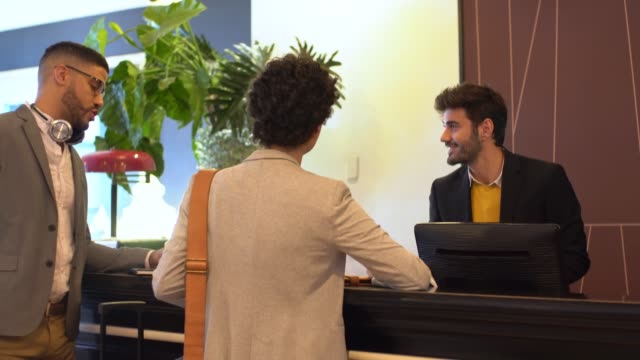young couple at the hotel reception - receptionist stock videos & royalty-free footage