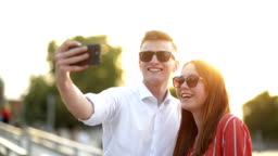 Young Couple at the Meeting. Romantic Couple Taking a Selfie with Smartphone. Love, Dating, Romance