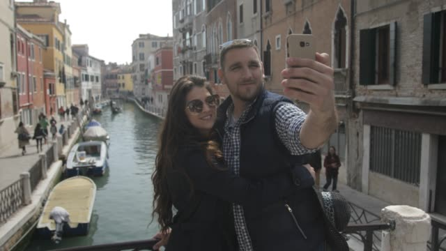 young couple at venice - tourist stock videos & royalty-free footage
