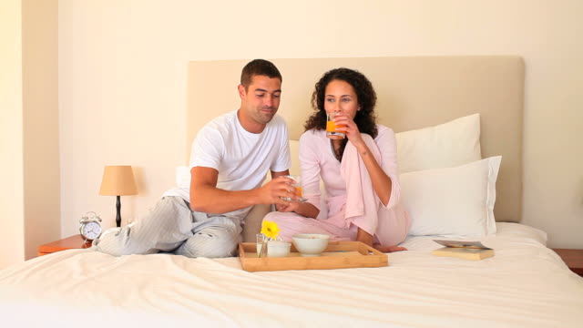 young couple breakfasting on their bed / cape town, western cape, south africa - nightdress stock videos & royalty-free footage