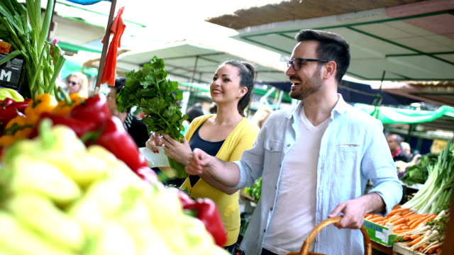 young couple buying groceries at the market. - young couple stock videos & royalty-free footage
