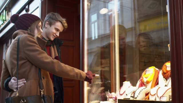 young couple buying the jewelry - window display stock videos and b-roll footage