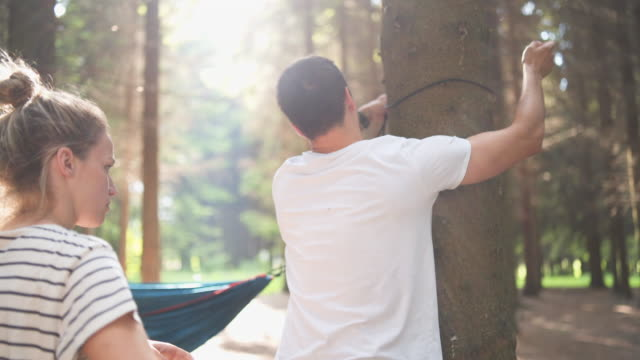 young couple camping together - hammock stock videos & royalty-free footage