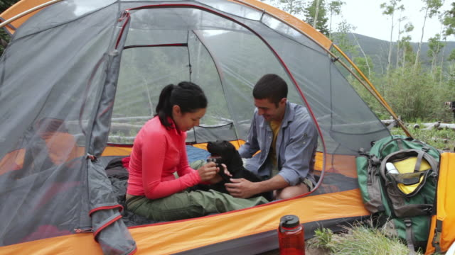 MS Young couple camping with their dog / Santa Fe, New Mexico, United States