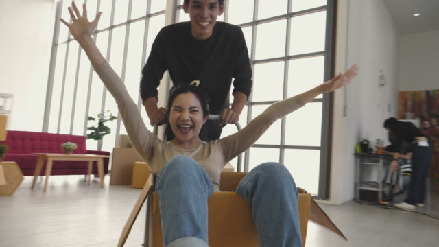 young couple celebrating a new house - arranging stock videos & royalty-free footage