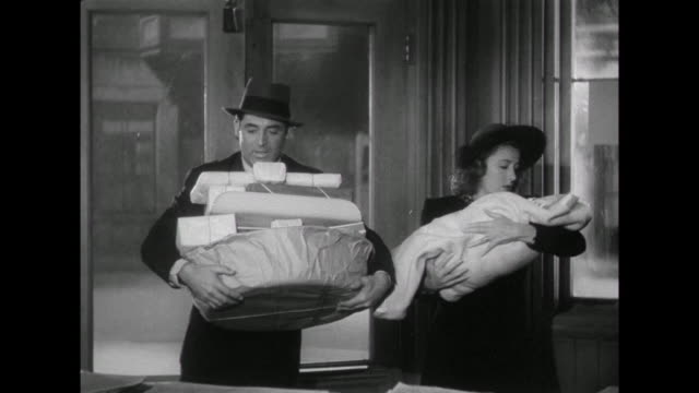 1941 Young couple ( Cary Grant & Irene Dunne) come home with new baby