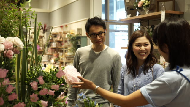 young couple come to buying flowers - retail place stock videos & royalty-free footage