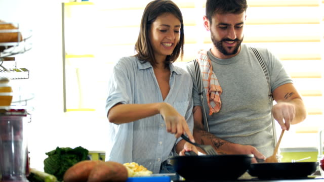 young couple cooking at home. 4k - stirring stock videos & royalty-free footage