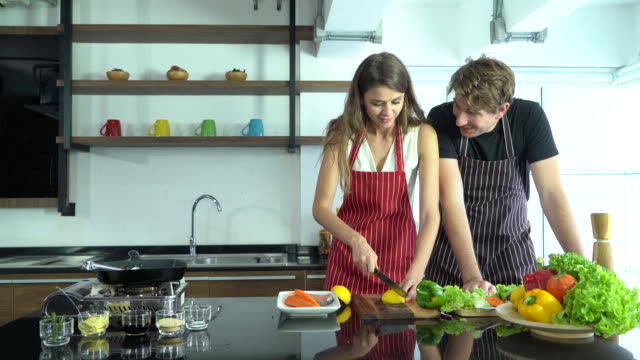 young couple cooking at home - husband stock videos & royalty-free footage
