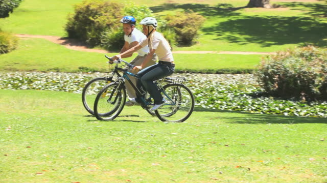 young couple cycling / cape town, western cape, south africa - cycling helmet stock videos & royalty-free footage