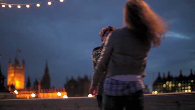 young couple dance on the south bank of london at night. - big ben stock videos & royalty-free footage