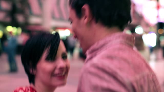 young couple dance together on fremont street - out of breath stock videos and b-roll footage