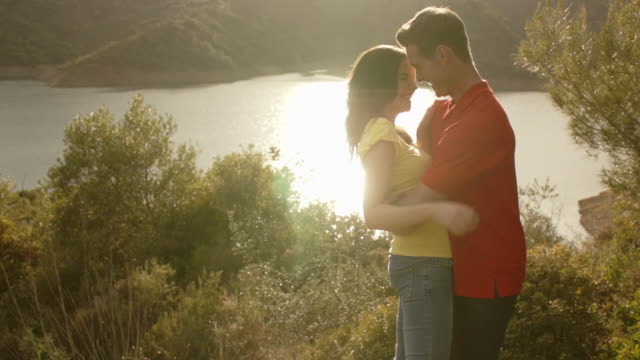 young couple dancing by lake. - slow dancing stock videos and b-roll footage