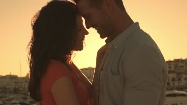 young couple dancing by marina in sunset. - slow dancing stock videos and b-roll footage