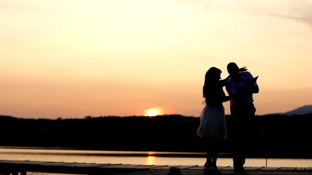 young couple dancing on  sunset - slow dancing stock videos and b-roll footage