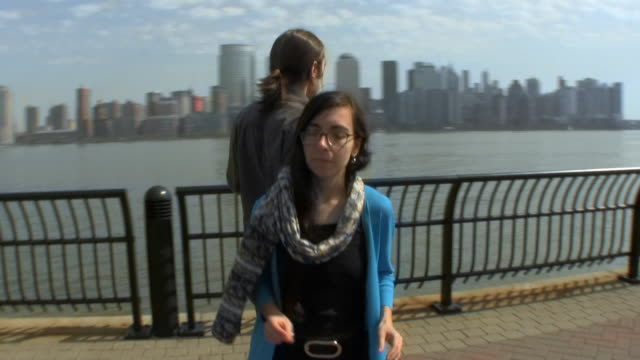 MS PAN TD Young couple dancing with New York City in background / Jersey City, New Jersey, USA