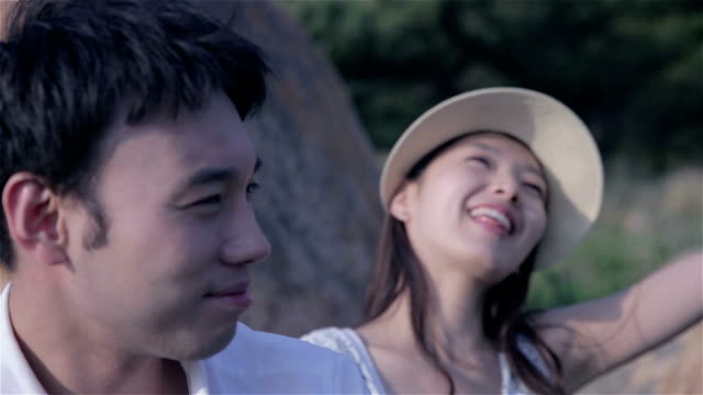 young couple dating on a park bench - korea点の映像素材/bロール