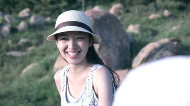 young couple dating on grass field - south korea couple stock videos & royalty-free footage