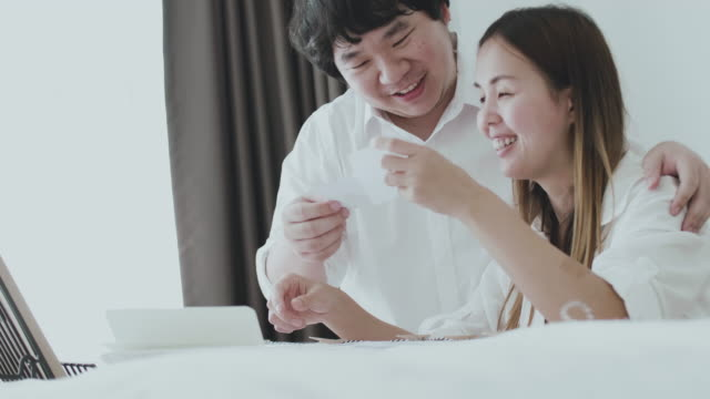 diy : young couple decorating home with photo - couple relationship photos stock videos & royalty-free footage