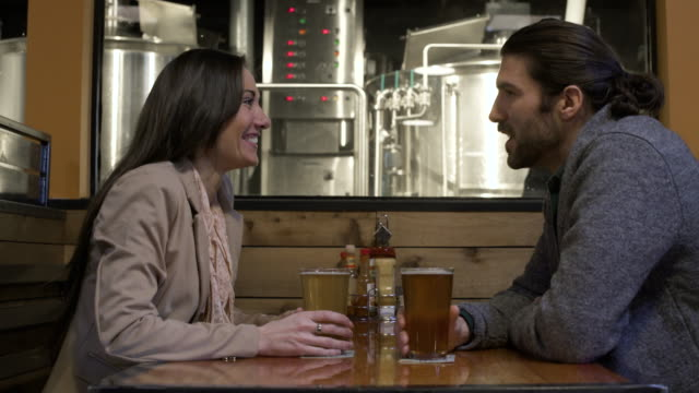 Young couple drinking beer in a bar
