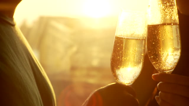 vidéos et rushes de cu tu la young couple drinking champagne standing by window at sunset, brooklyn, new york city, new york state, usa - champagne