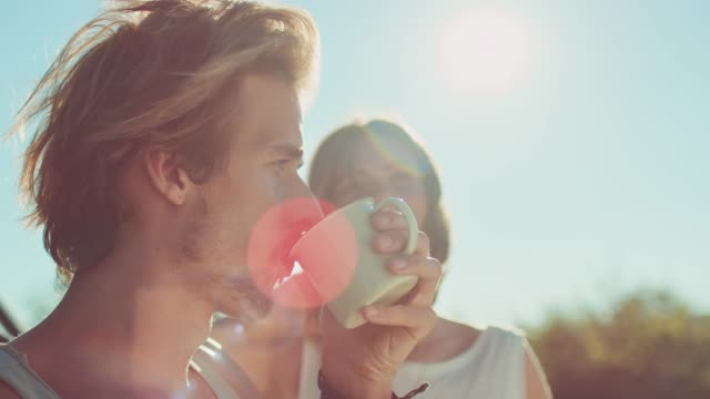 young couple drinking coffee during sunny day - mug stock videos & royalty-free footage