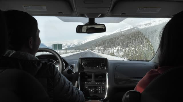 Young couple driving in Winter